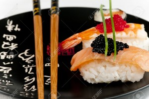 15356930-Smoked-salmon-and-prawn-nigiri-and-norimaki-sushi-garnished-with-red-and-black-fish-eggs-and-chives--Stock-Photo